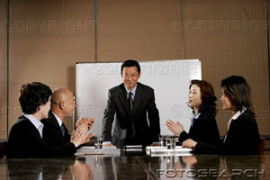 Business man and women clapping their hands after a good presentation.jpg